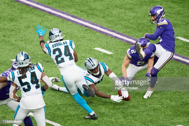Natrell Jamerson of the Carolina Panthers blocks a point after a touchdown attempt by Dan Bailey of the Minnesota Vikings during the fourth quarter...