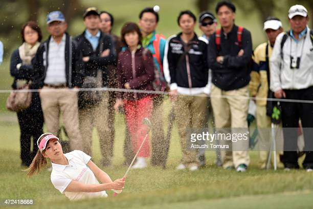 Natsuka Hori of Japan hits her shot out from a bunker onto the 8th green during the first round of the World Ladies Championship Salonpas Cup at the...