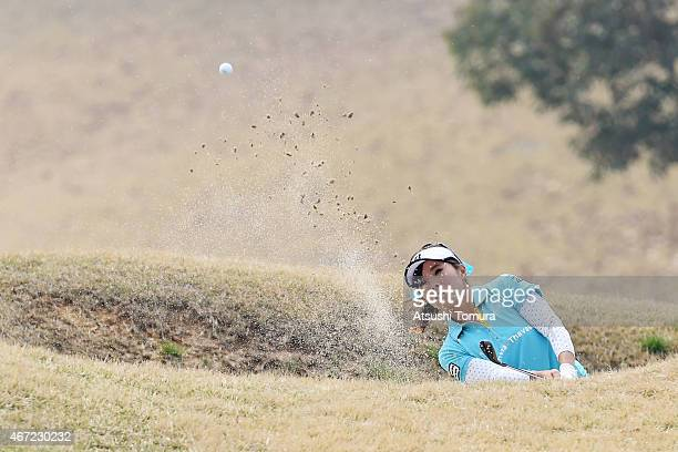 Natsuka Hori of Japan hits out of a bunker on the 12th hole during the final round of the TPoint Ladies Golf Tournament at the Wakagi Golf Club on...