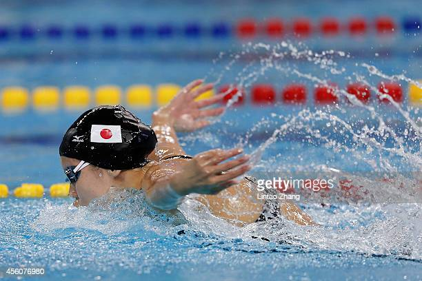 Natsumi Hoshi of Japan competes during the swimming Women's 4 x 100m Medley Relay Final in day six of the 2014 Asian Games at Munhak Park Taehwan...