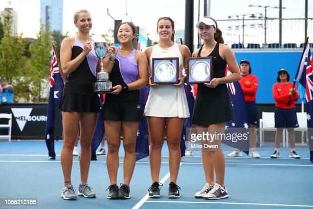 Natsumi Kawaguchi of Japan and Adrienn Nagy of Hungary celebrate winning the Junior Girls Doubles match against Chloe Beck and Emma Navarro of the...