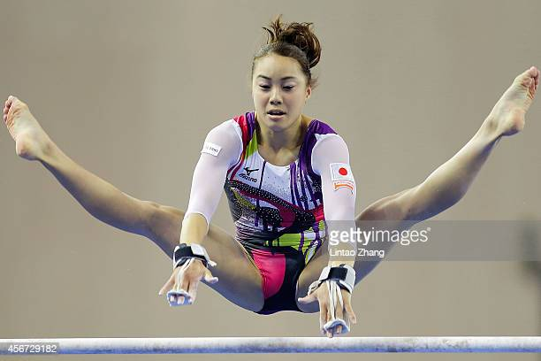 Natsumi Sasada of Japan performs on the uneven bars during the women's qualification of the 45th Artistic Gymnastics World Championships at Guangxi...