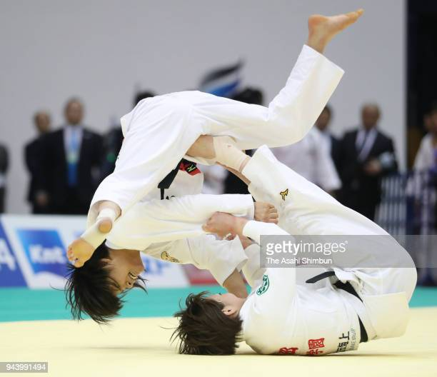 Natsumi Tsunoda throws Uta Abe in the Women's 52kg semifnal on day two of the All Japan Judo Championships by Weight Category at Fukuoka Convention...