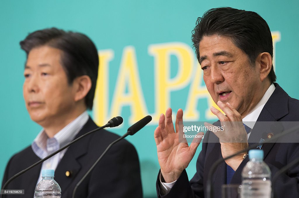 Natsuo Yamaguchi, chief representative of the New Komeito Party, left, looks on as Shinzo Abe, Japan's prime minister and president of the Liberal Democratic Party (LDP), speaks during their debate ahead of the upper house election at the Japan National Press Club in Tokyo, Japan, on Tuesday, June 21, 2016. It is for Bank of Japan to decide what monetary policy methods to use Abe during the debate. Photographer: Tomohiro Ohsumi/Bloomberg via Getty Images