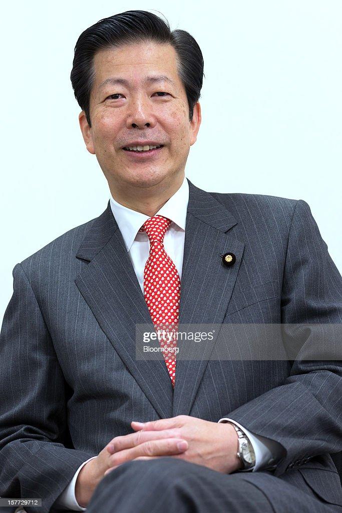 Natsuo Yamaguchi, head of the New Komeito party, poses for a photograph following an interview in Tokyo, Japan, on Thursday, Dec. 6, 2012. Japan's Liberal Democratic Party (LDP) should tone down its pledges on inflation targeting and increased defense spending, the party's key ally said ahead of Dec. 16 parliamentary elections the LDP is forecast to win. Photographer: Noriyuki Aida/Bloomberg via Getty Images