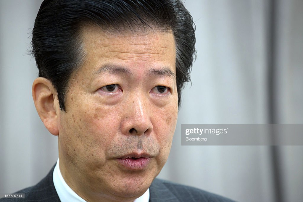 Natsuo Yamaguchi, head of the New Komeito party, speaks during an interview in Tokyo, Japan, on Thursday, Dec. 6, 2012. Japan's Liberal Democratic Party (LDP) should tone down its pledges on inflation targeting and increased defense spending, the party's key ally said ahead of Dec. 16 parliamentary elections the LDP is forecast to win. Photographer: Noriyuki Aida/Bloomberg via Getty Images