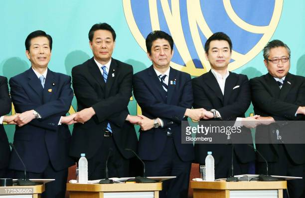 Natsuo Yamaguchi president of the New Komeito party from left Banri Kaieda president of the Democratic Party of Japan Shinzo Abe Japan's prime...