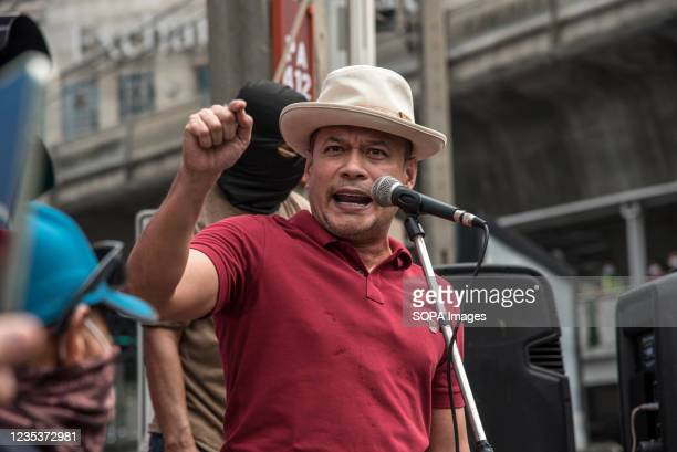 Nattawut Saikua, a core leader speaks during the car mob rally. Anti-government protesters gathered at Asok intersection before they drove their...