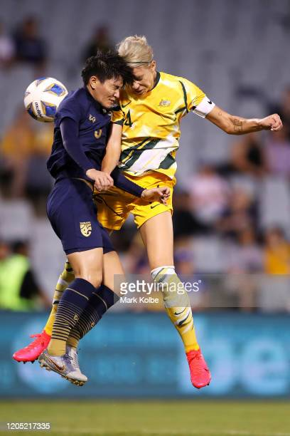 Natthakarn Chinwong of Thailand and Alanna Kennedy of the Matildas collide as they compete for the ball during the Women's Olympic Football...