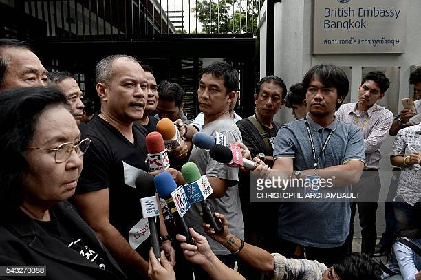 Natthawut Saikua a leader of Thailand's prodemocracy 'Red Shirt' street movement answers reporters' questions outside the British Embassy in Bangkok...