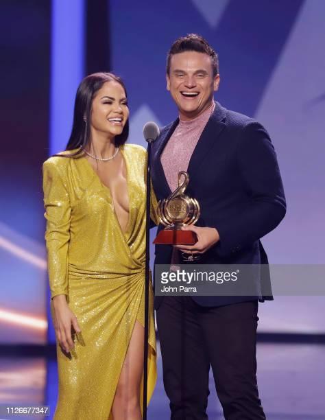 Natti Natasha and Silvestre Dangond accept an award on stage at Univision's 31st Edition Of Premio Lo Nuestro A La Musica Latin at American Airlines...