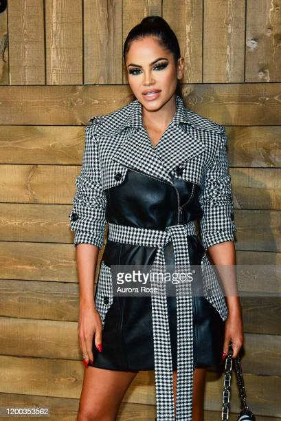 Natti Natasha attends the Michael Kors AW/20 Fashion Show at American Stock Exchange on February 12 2020 in New York City