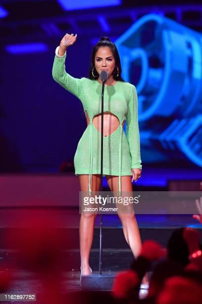 Natti Natasha speaks on stage during Premios Juventud 2019 at Watsco Center on July 18 2019 in Coral Gables Florida