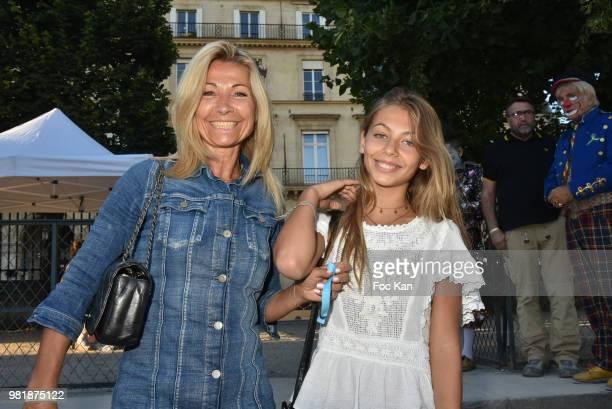 Natty Belmondo and her daughter Stella Belmondo attend Fete des Tuileries on June 22 2018 in Paris France