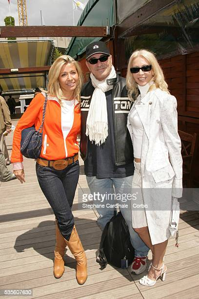 Natty Belmondo JeanMarie Bigard with his wife visit Roland Garros village during the 2006 French Open tennis