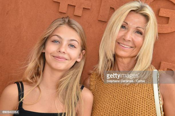 Natty Belmondo with her daughter Stella Belmondo attend the 2017 French Tennis Open Day Four at Roland Garros on May 31 2017 in Paris France
