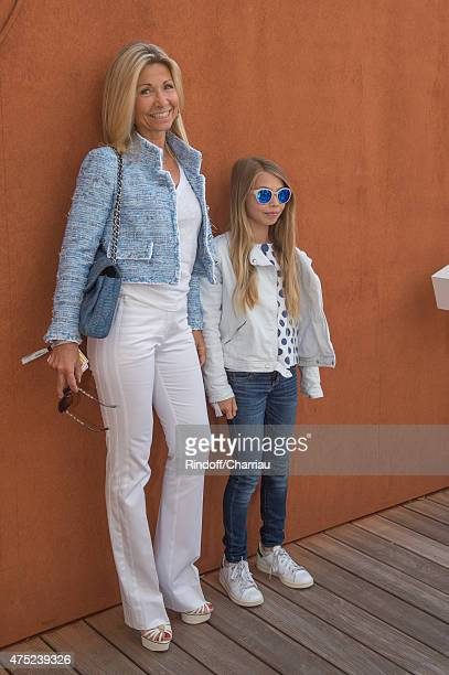 Natty Tardivel and her daughter Stella attends the French Open 2015 at Roland Garros on May 30 2015 in Paris France