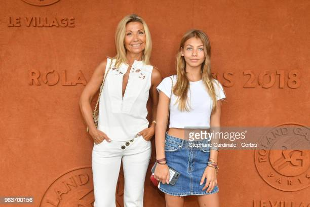 Natty Tardivel and Stella Belmondo attend the 2018 French Open Day Four at Roland Garros on May 30 2018 in Paris France