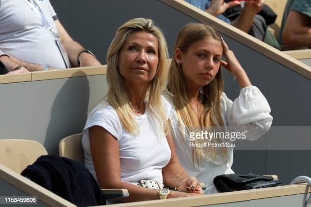 Natty Tardivel and Stella Belmondo attend the 2019 French Tennis Open Day Nine at Roland Garros on June 03 2019 in Paris France