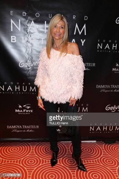 Natty Tardivel is photographed for Paris Match at the Birthday party for the 60th anniversary of jeweler Edouard NAHUM organized at the Musée Grévin...