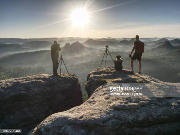 natur photographers on trail with tripod and backpack. popular place for workshops and sharing ideas - natur stock pictures, royalty-free photos & images