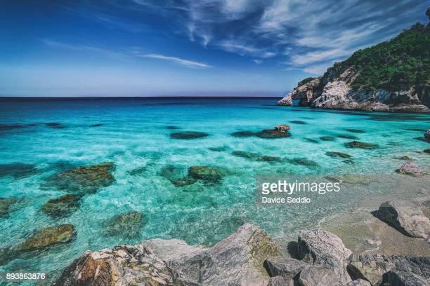 natural arch and azure water at the cove 'cala goloritze' - cala goloritze foto e immagini stock