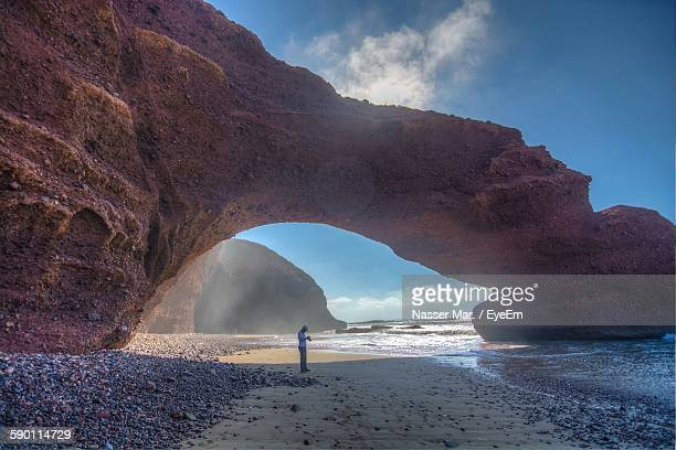 natural arch by sea shore - agadir stock pictures, royalty-free photos & images