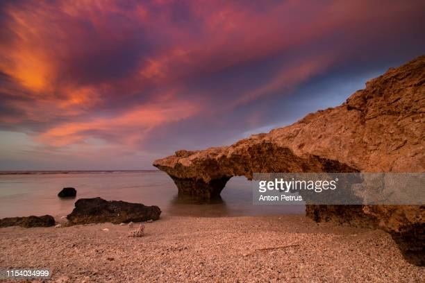 natural arch on the red sea at sunset. egypt - red sea stock pictures, royalty-free photos & images