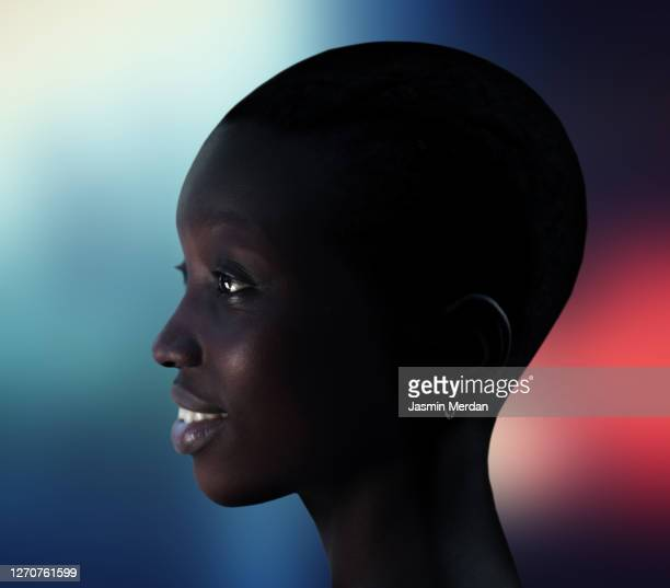 natural beauty african american beautiful woman profile portrait - portrait blue background stock pictures, royalty-free photos & images