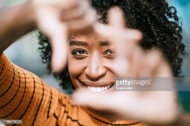 natural beauty portrait with womans finger frame - image focus technique stock pictures, royalty-free photos & images