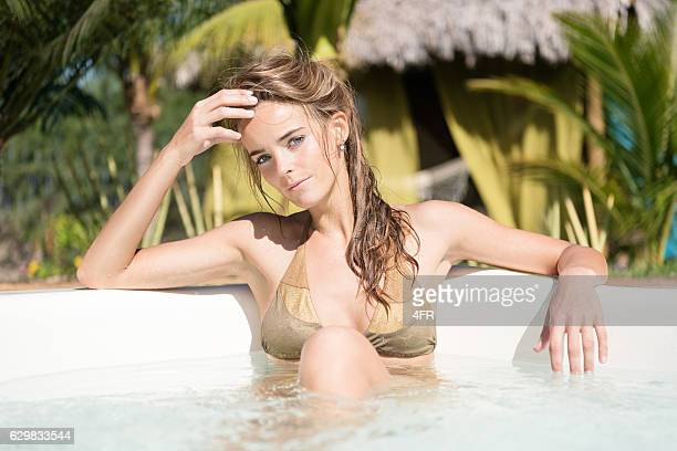 Natural Beauty relaxing in a Whirlpool between Palm Trees
