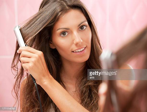 Natural Beauty straightening her long Hair