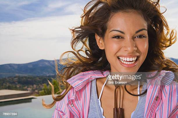 Natural beauty woman laughs outside in nature.