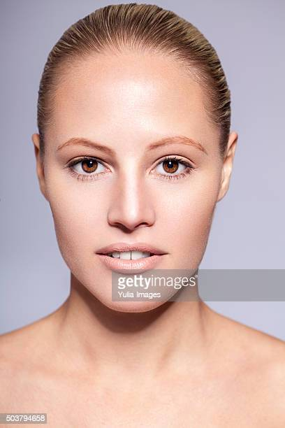Natural Blond Woman with Bare Shoulders in Studio