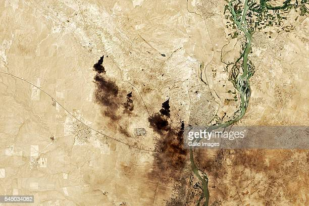 A natural colour satellite image taken June 30 2016 Burning oil and smoke plumes can be seen in Qayyarah near the Tigris River Mosul Iraq