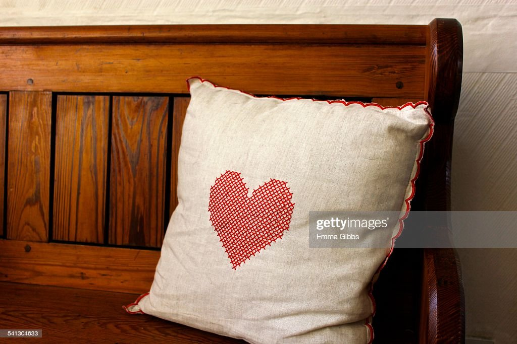 Natural coloured cushion with red nordic heart : Stock Photo