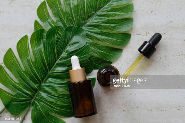 natural essential oils on marble background - essential oil stock pictures, royalty-free photos & images