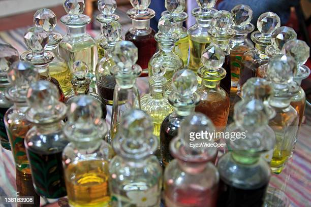 Natural ethereal oils like pure sandalwood oil used as basis for perfumes offered at December 18 2011 in Mysore Karnataka India