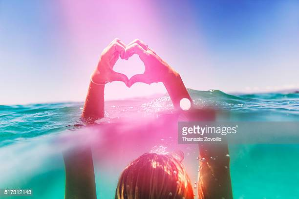 Natural Female Hands Heart in the sea