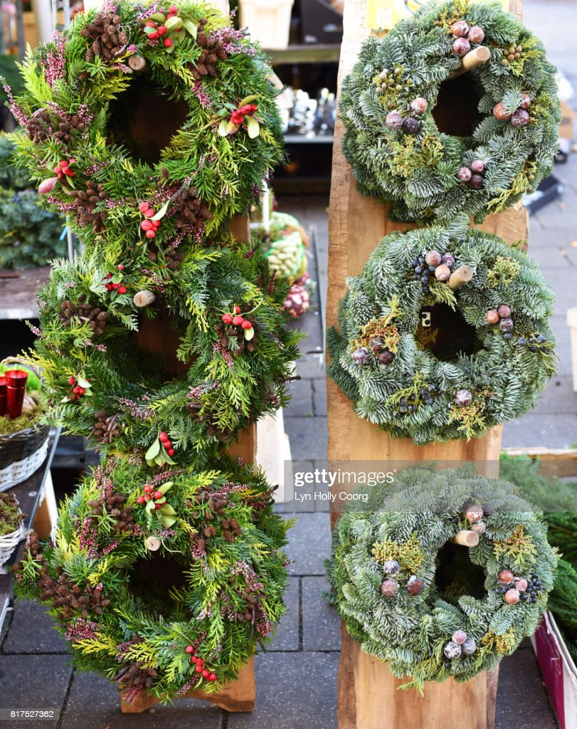 Natural foliage Christmas wreaths for sale in German market : Stock Photo