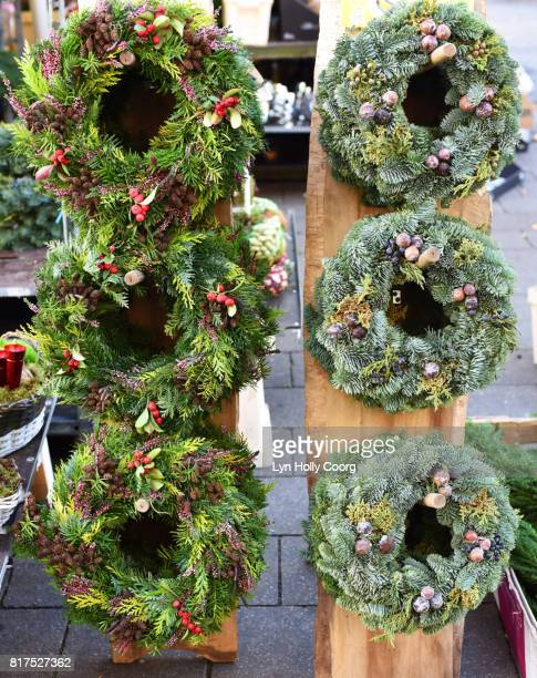 natural foliage christmas wreaths for sale in german market - lyn holly coorg stock photos and pictures