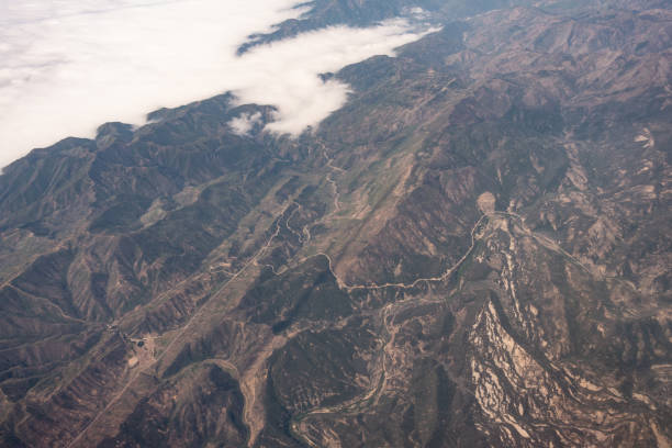 Natural forest in California, daytime aerial view from airplane