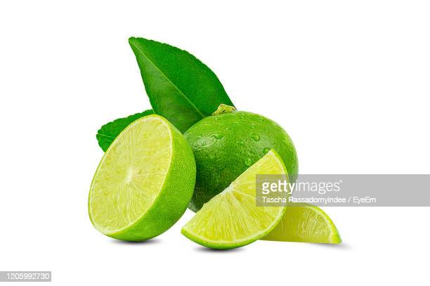 natural fresh lime with water drops and slice of green lime citrus fruit stand isolated - part of stock pictures, royalty-free photos & images