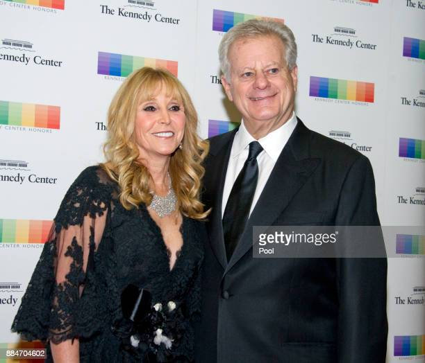 Natural gas billionaire Michael S Smith and his wife Iris arrive for the formal Artist's Dinner hosted by United States Secretary of State Rex...