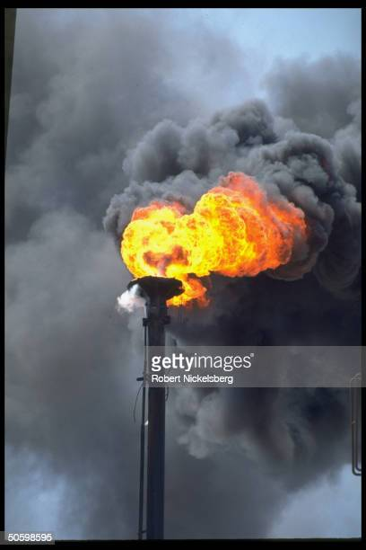 Natural gas burn-off emitting fire & polluting smoke fr. Oil refinery stack .