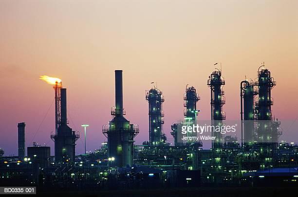 Natural gas refinery illuminated at dusk, Scotland