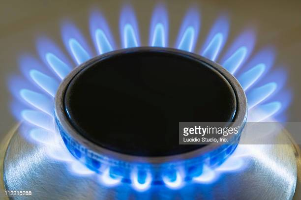 Natural gas stove burner showing blue flame