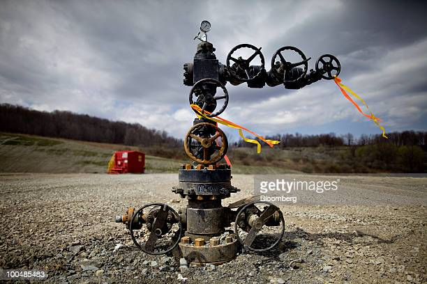 A natural gas wellhead stands on an Alta Resources LLC drill site near Montrose Pennsylvania US on Monday April 5 2010 Companies are spending...