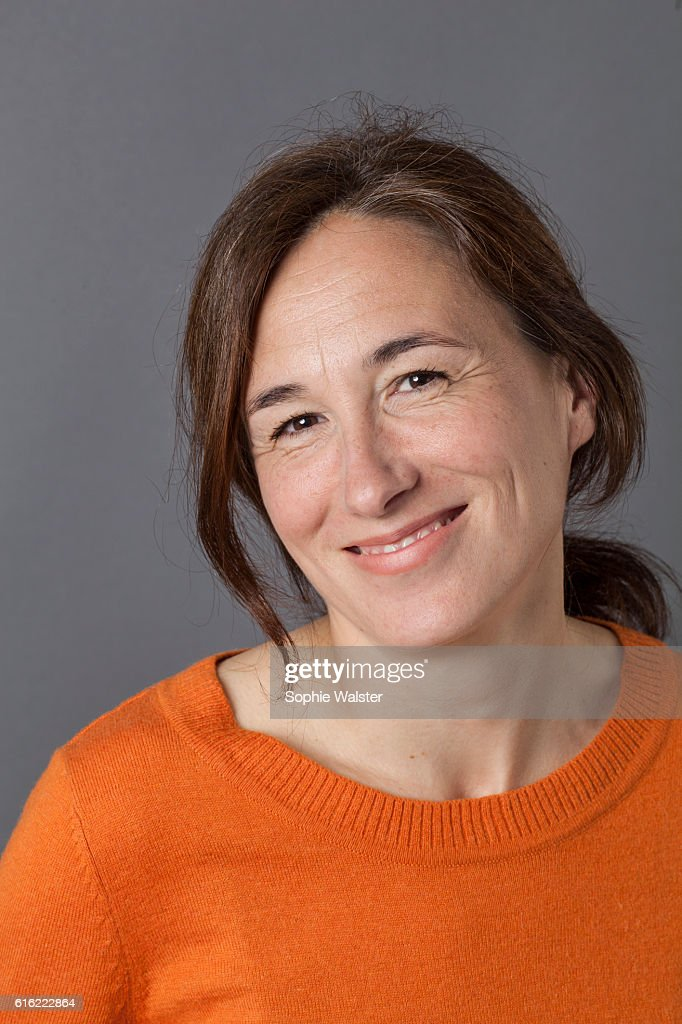 natural, gorgeous middle aged woman smiling for serenity and wellness : Bildbanksbilder