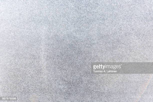 natural granite stone abstract texture background. - grainy stock pictures, royalty-free photos & images